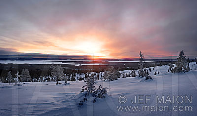 Winter sunrise over Lapland snow landscape