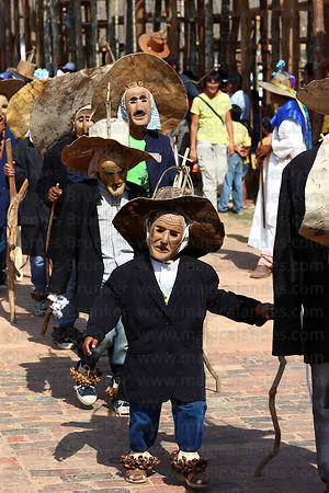 Achus (masked old man figures) during main procession of festival, San Ignacio de Moxos, Bolivia