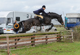 Nicky Hanbury jumping a hunt jump behind the kennels
