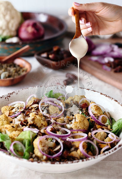 Roasted Cauliflower Salad with Lentils, Dates, Onions, and Tahini Dressing