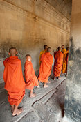 monks walking in the gallery, Angkor Wat, Siem Reap, Cambodia