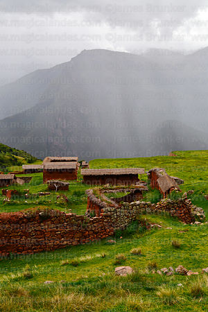 View of Inca site of Huchuy Qosqo, rainstorm over Urubamba valley, Cusco Region, Peru