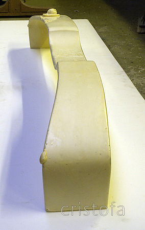 A foam blank for the rear crossbeam - tubular carbon fibre braid is fed over the blank before it goes into the mould