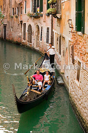 Gondola on a canal in Venice