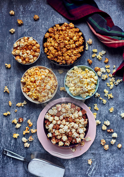 Five bows of various flavored popcorn