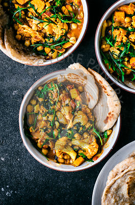 Cauliflower sweet potato curry with arugula and naan.