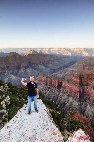 Man looking at view, Bright Angel Point, Grand Canyon, USA