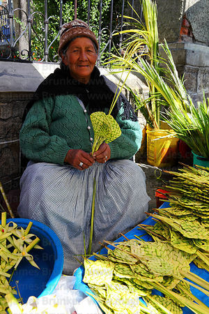 Old lady selling ornaments and crosses made out of palm leaves on Palm Sunday , La Paz , Bolivia