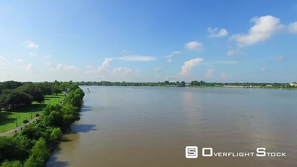 Aerial footage flying downriver on the Mississippi at Butterfly Park in New Orleans