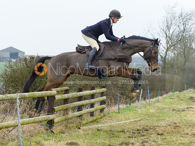 Gaby Vaughan jumping a hunt jump near Sewstern