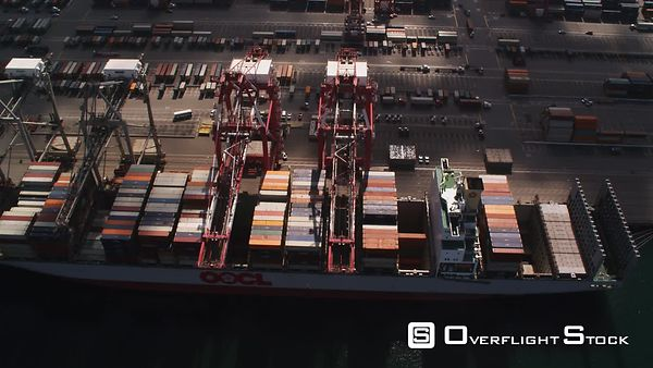 Flying Over Shipping Containers and Loading Cranes at a Dock in Port of Long Beach, Los Angeles.