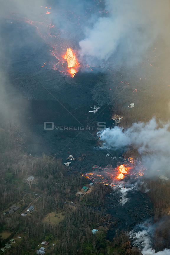 Lava emanating from Pu'u O'o, Kilauea Volcano, erupting from multiple fissures in Leilani Estates, near Pahoa, Puna, Hawaii.