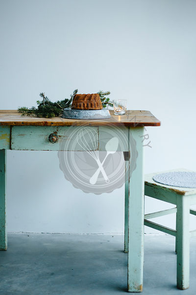 Cake on a vintage table and chair aside