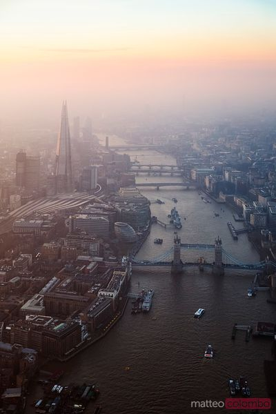 Aerial of the Tower bridge and the Shard at sunset, London