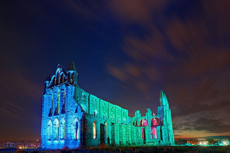 Whitby Abbey illuminated in blue