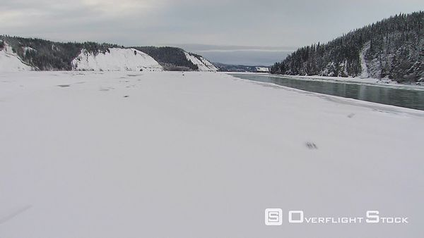 Flying fast over icy river in Alaska