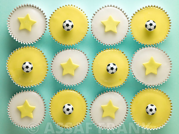 Cupcakes with stars and football shape decorations