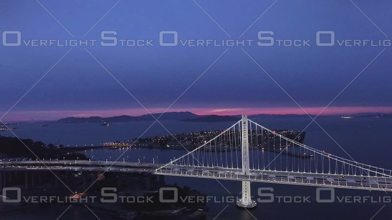 San Francisco Bay Bridge Aerial Fly Toward South Side Treasure Island Evening Sky. California