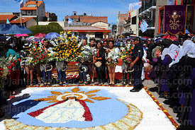 Devotees wait to pay respect to Virgen de la Candelaria during main procession for festival, Puno, Peru