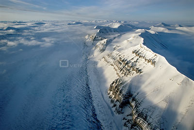 Aerial of mountains and glacier stream in Svalbard, Norwegian Arctic, June 2004