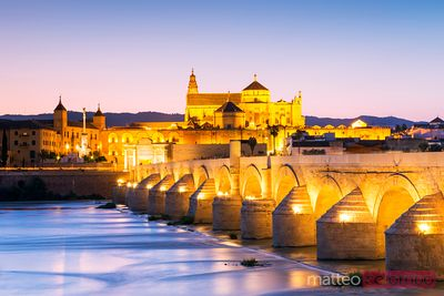 Famous roman bridge of Cordoba at dusk, Spain
