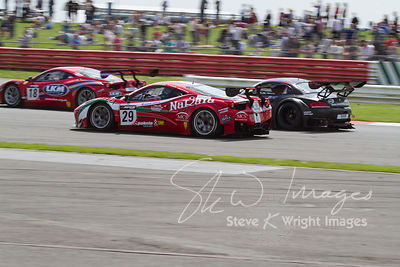 The AF Corse Ferrari 458 Italia GT3 and Triple Eight BMW Z4 GT3 teams in action at the Silverstone 500 - the third round of t...