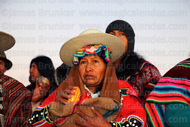 Aymara leader holding maize offerings during Aymara New Year celebrations, Tiwanaku, Bolivia