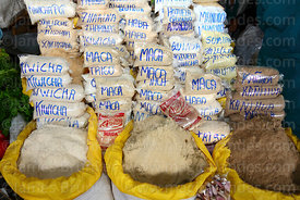 Stall selling a variety of flours including kiwicha, maca and kañihua in San Pedro market, Cusco, Peru