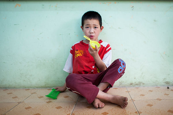 Dzong, 10 years old, has lived in the friendship village for 2 years. He suffers from a triple handicap: autistic spectrum di...