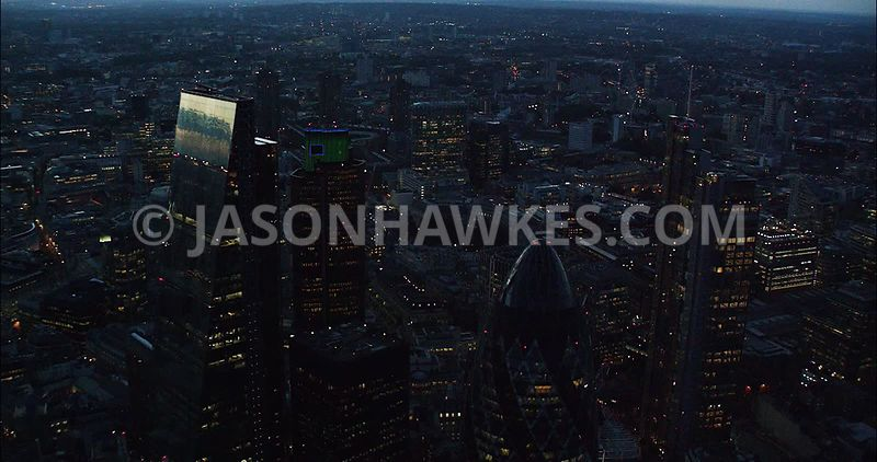 London Aerial Footage of City of London with Leadenhall Building at night.