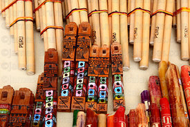 Quenas, tarkas and panpipes for sale in market , Cusco, Peru