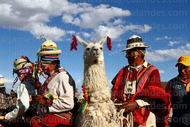 Aymara men with prize winning llama at rural festival, Orinoca, Bolivia