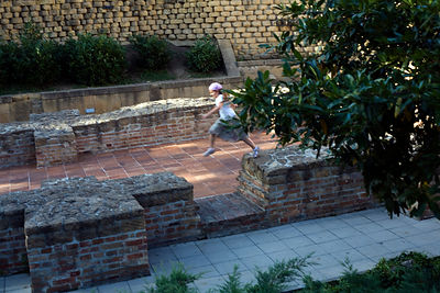 Hungary - Pecs - Children play over the ruins of the early Christian Tomb chapel
