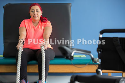 Personal Trainer Assisting Disabled Woman