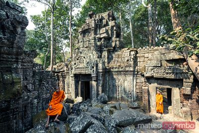 Buddhist monks inside temple, Angkor Wat, Cambodia