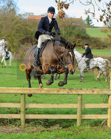 Nicky Hanbury jumping a hunt jump