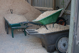 wheelbarrows full of shavings for horse stalls