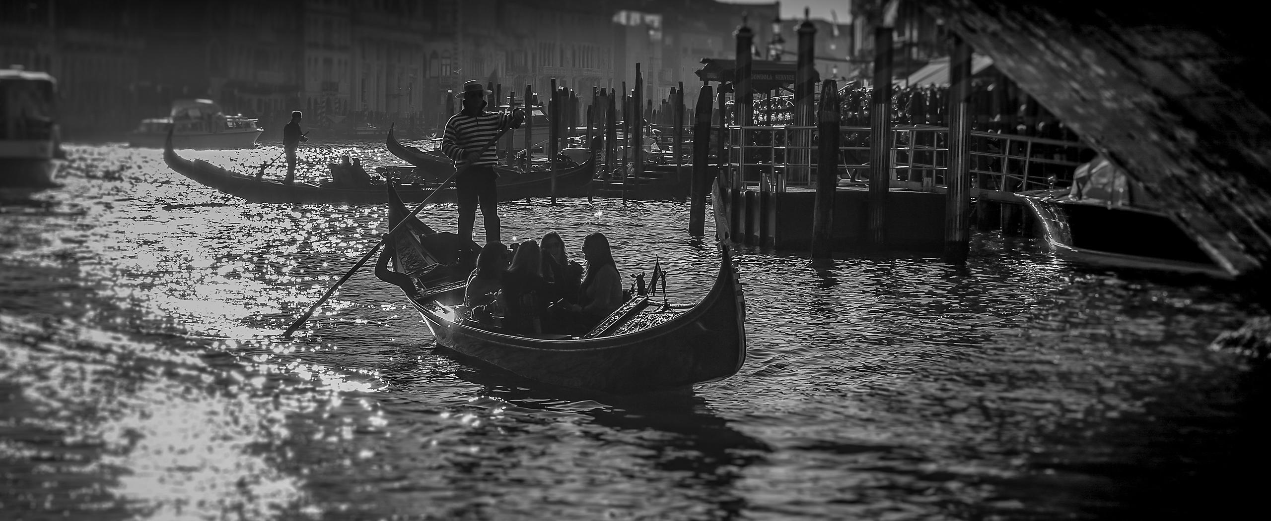 Silhouette of Gondola going under the Rialto Bridge, Venice