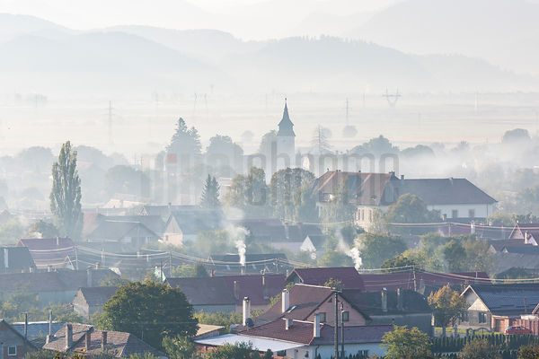 Smoky Foggy Morning in a Transylvania Town