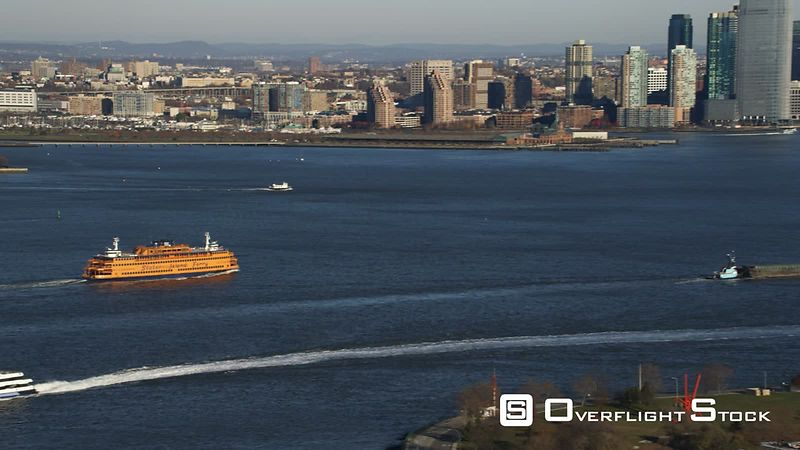 Staten Island Ferry and Jersey City Skyline in View as Flight Begins to Cross Governor's Island and Turns Toward Lower Manhat...