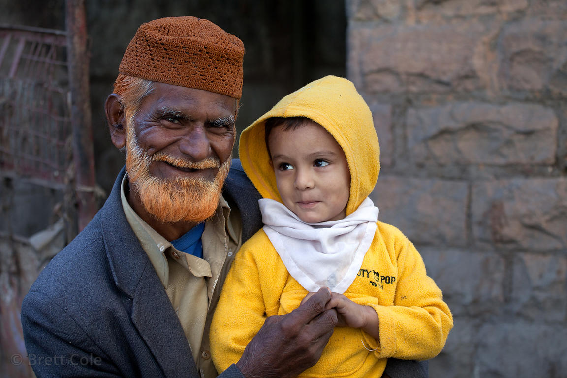 Elderly man with a red beard and his grandson in Jodhpur, Rajasthan, India