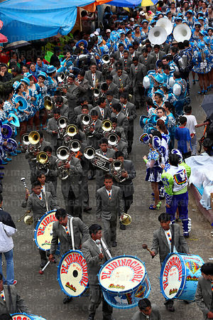 Brass band and Caporales dancers from above at Oruro Carnival, Bolivia