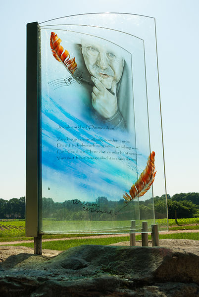 monument Willem Wilmink - close up of glass book with portrait and poem