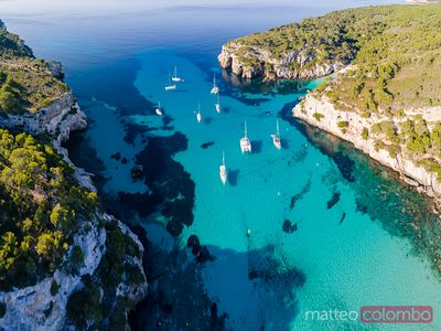 Aerial of bay and yachts, Cala Macarella, Menorca