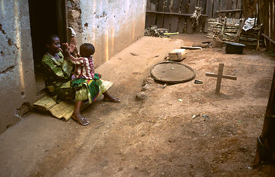 Rwanda - Kibileze - Teacher Potamienne Komezusenge (37) plays with her youngest child