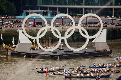 The Olympic Torch Bearer under the Rings on The River Thames