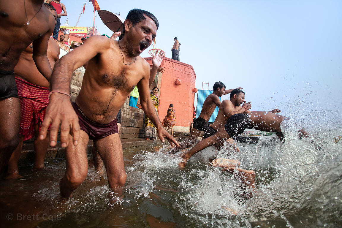 Bathers dive into the Ganges River, Varanasi, India.