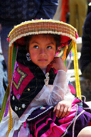 Girl wearing traditional dress during Virgen del Carmen festival , Paucartambo , Peru