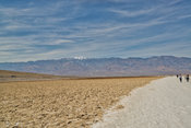 Hikers Walk The Bad Water Salt Flats- Death Valley