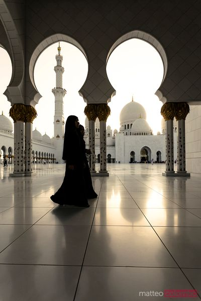 Arabic women walking inside Shiek Zayed mosque, Abu Dhabi, UAE